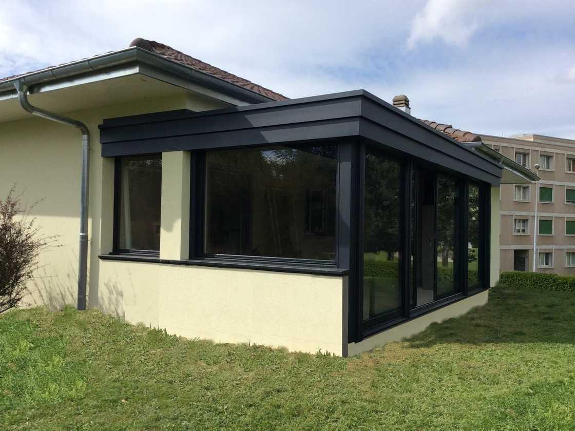 Véranda avec muret à Bulle – canton de Fribourg